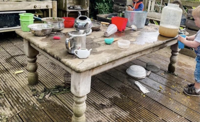Concoctions in the Roseville Childcare mud kitchen